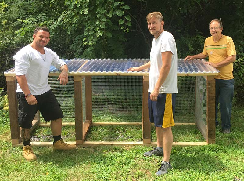 Doug, Max and Jim building the official Manor of Hope compost bin!