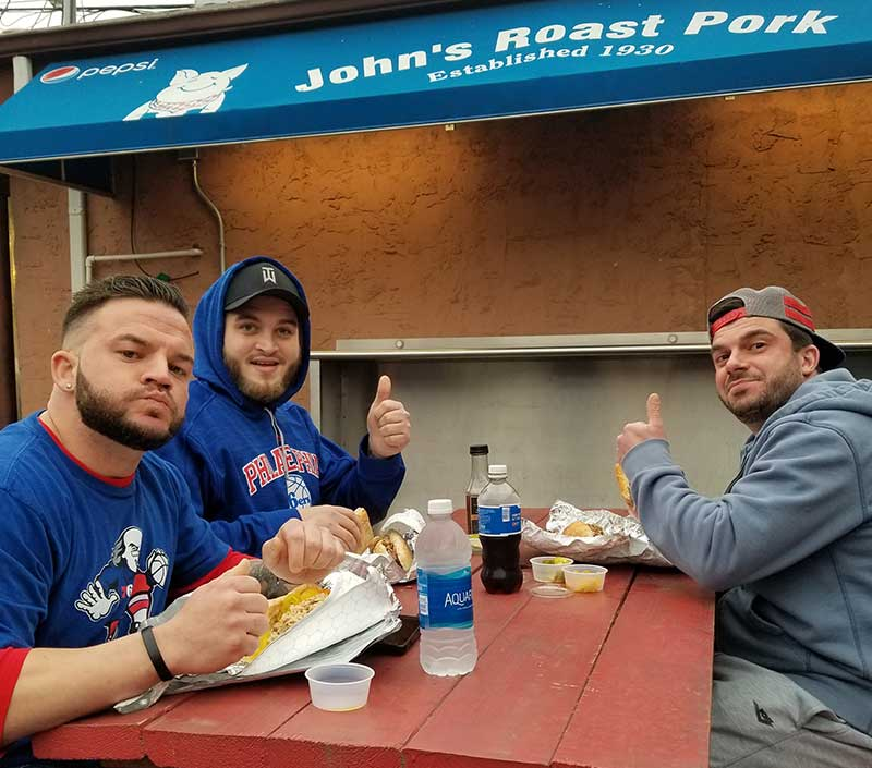 Doug, Elliot and Steve give the thumb's up to John's roast pork sandwhiches