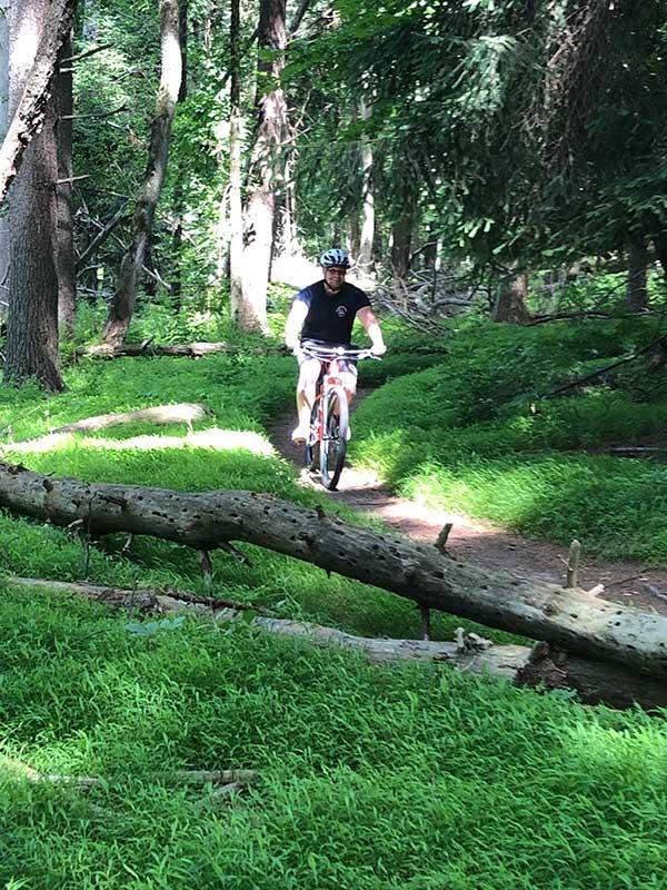 trail biking through the woods
